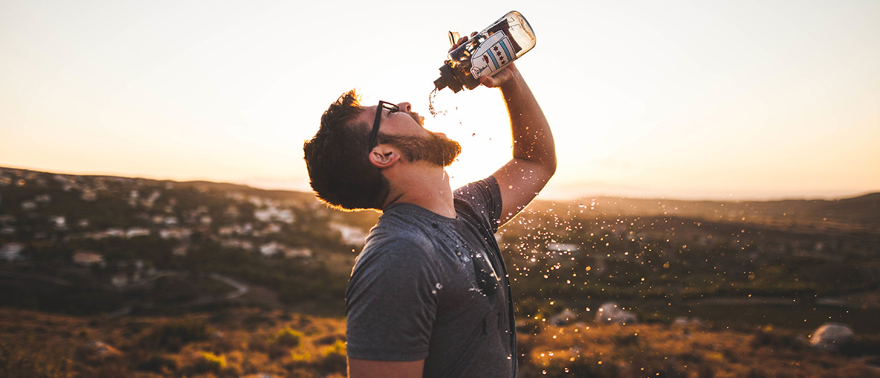 Man drinking out of a bottle of water