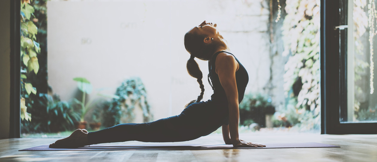Woman doing an upward dog yoga pose