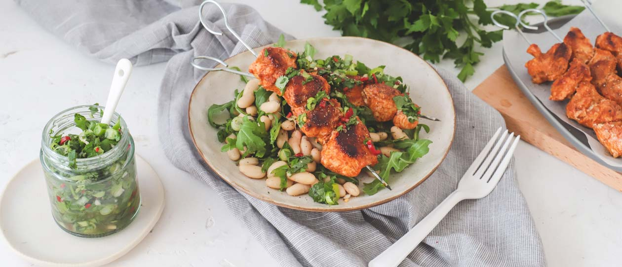 Chimichurri chicken skewers and white bean salad