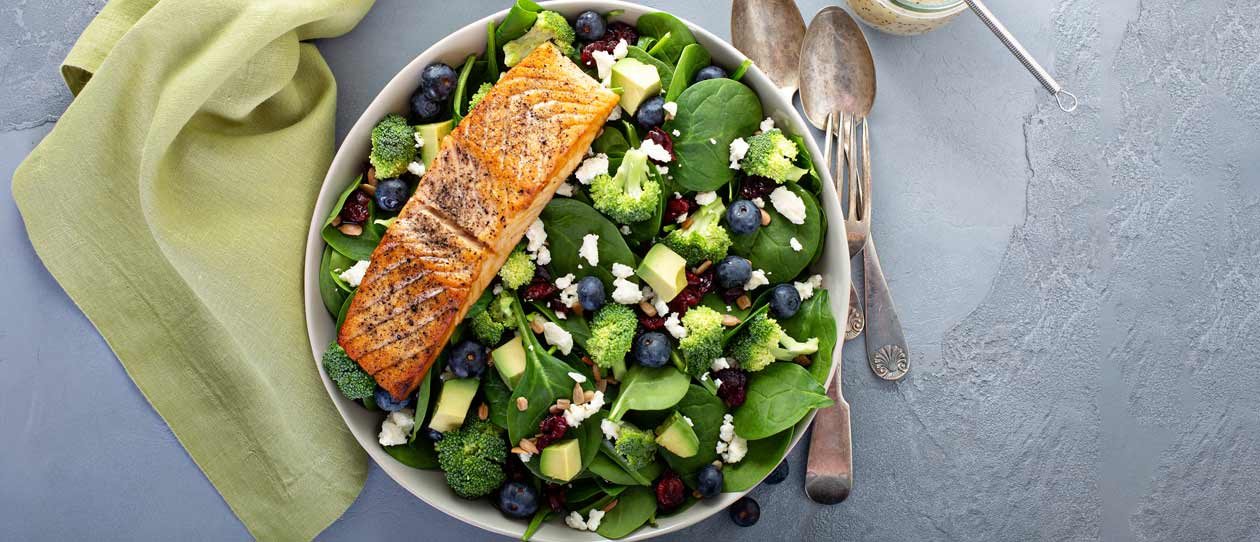 Spinach and blueberry salad with grilled salmon